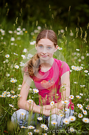 Teen girl in a field of daisies