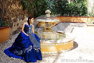 Teen girl in a fountain