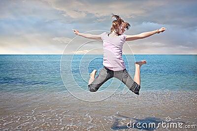 Teen girl freedom jump in water