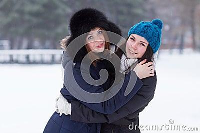 Teen girl friends outdoors in winter