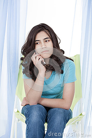Teen girl girl on stressful phone conversation