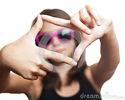 Teen girl with glasses make frame with her fingers