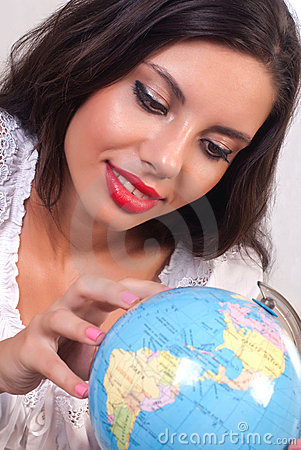 Teen girl with globe