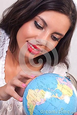 Teen girl with globe