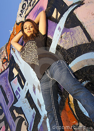 Teen Girl with graffiti wall background