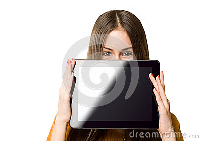 Teen girl having fun with tablet computer.