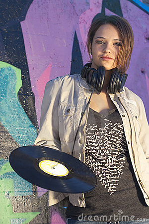 Teen Girl with Headphones and Record