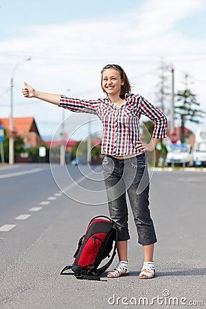 Teen girl hitch hiking