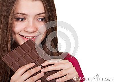 Teen girl holding big chocolate bar