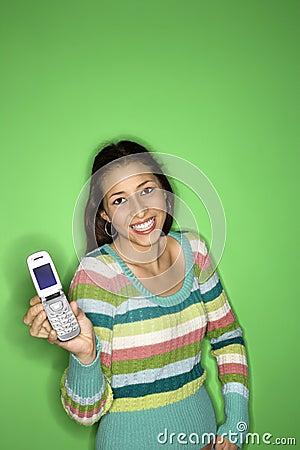 Teen girl holding cellphone.