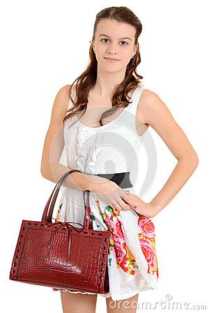 Teen girl holding a purse