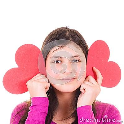 Teen girl holding valentines