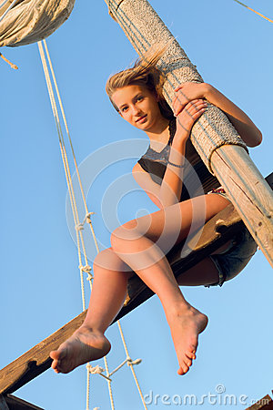 Teen girl hugging the mast