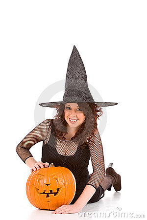 Free Teen Girl In Halloween Hat With Carved Pumpkin Royalty Free Stock Photography - 6537767