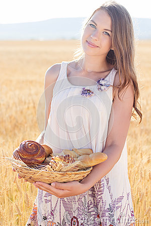 Free Teen Girl In Rye Field With Basket Of Buns Stock Photos - 73431763