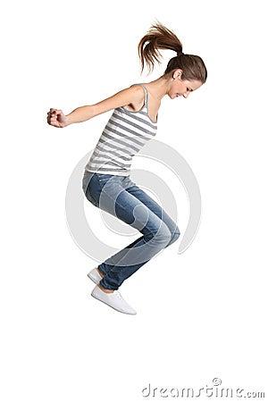 Teen girl jumping.