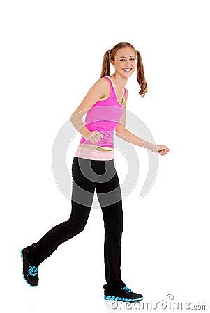 Teen girl laughing doing zumba fitness