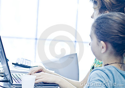 Teen girl learning computers