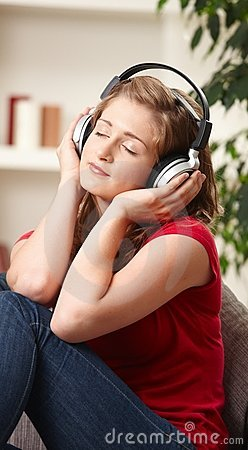 Teen girl listening to music at home