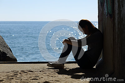Teen girl lonely and sadness on the beach