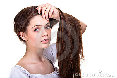 Teen girl with long hairs and clean skin
