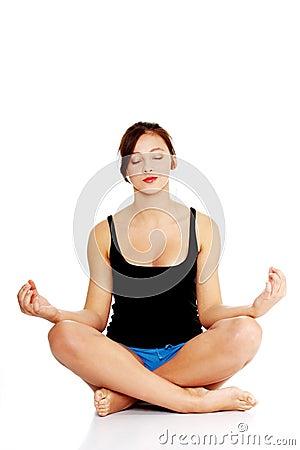 Teen girl meditating