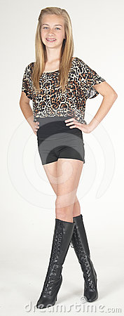 Teen Girl Modeling Fashion Clothes in Studio