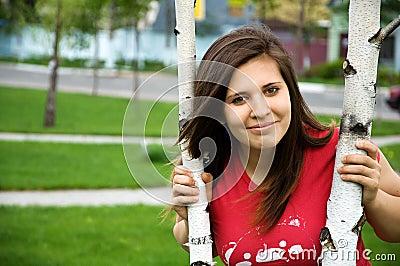 A teen girl near the tree