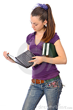 Teen girl with netbook and books
