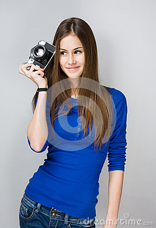 Teen girl with photo camera.