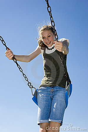 Teen Girl on Playground Swing