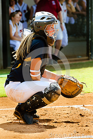 Teen girl playing softball