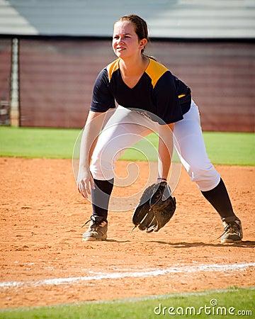 Teen girl playing softball