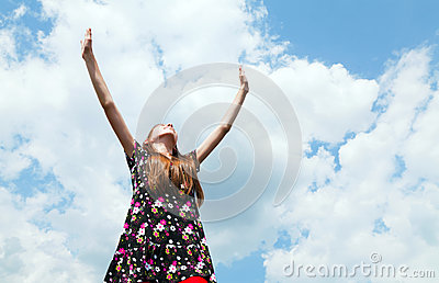 Teen girl with raised hands