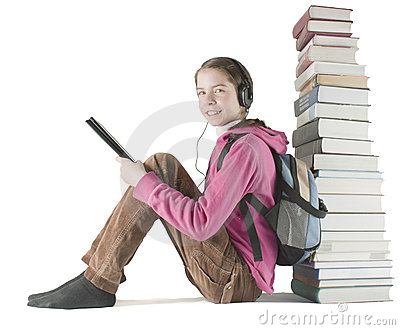 Teen girl reads ebook near the stack of books