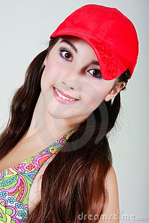 Teen girl in red cap