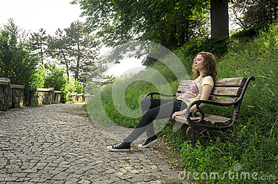 Teen girl relaxing on a bench