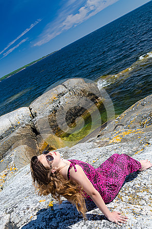 Teen girl relaxing on a sea coast