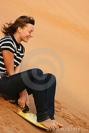 Free Teen Girl Riding On The Sand Dunes Sandboard Royalty Free Stock Images - 21693579