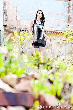 Teen girl on rubble