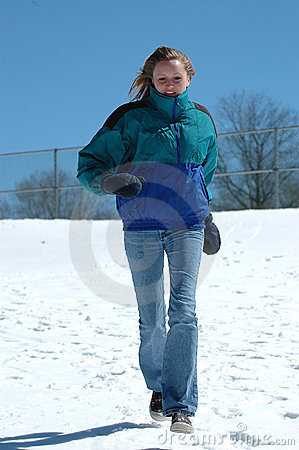 Teen girl running in snow