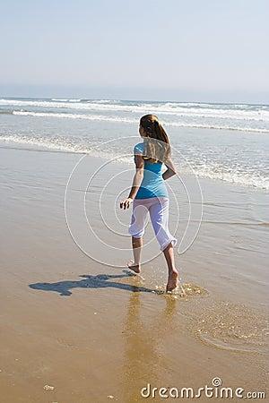 Teen Girl Running in the Surf