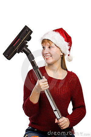 Teen girl in santa hat with vacuum cleaner
