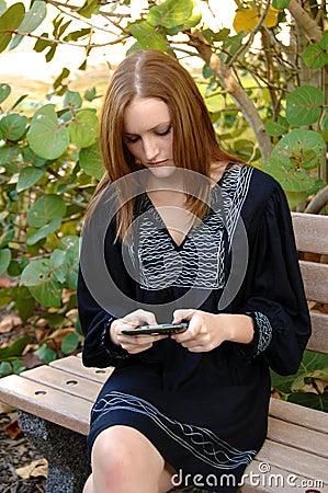 Teen girl sending text message