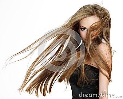 Teen girl shaking head with long hair