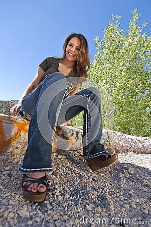 Teen Girl sitting on ledge