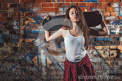 teen girl with skate board urban lifestyle stock photo