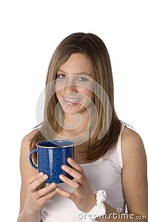 Teen girl smiling with coffee mug