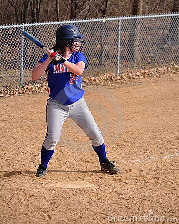 Teen Girl Softball Player Batting