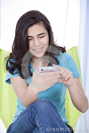 Teen girl texting on a cell phone